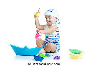 little child playing with fishing rod toy