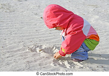 Little Child Playing with Sand