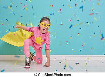 child plays superhero - Little child plays superhero. Kid on...