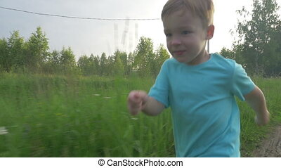 Little child running in the countryside - Slow motion...