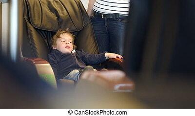 Little child sitting in massage chair