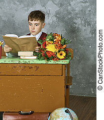 Little child stressed tired leaning on pile of books,