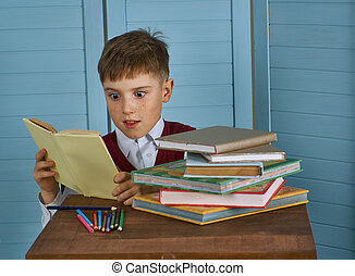 Little child stressed tired leaning on pile of books