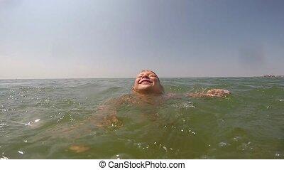 Little child swimming in the sea