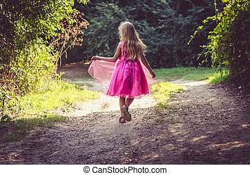 little child walking in the nature