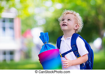 Little child with candy cone on first school day - Happy...