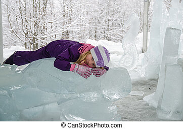 little child with ice sculpture - little blond girl with ice...