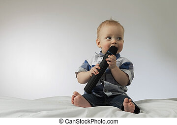 Little child with karaoke microphone