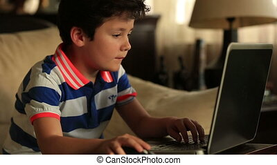 little child with laptop - smart little child study with...