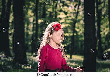 little child with soap bubbles