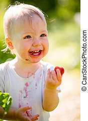Little child with strawberry - Pure joy - cute happy baby...