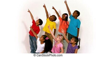 Little children all pointing up - Cute little children all ...