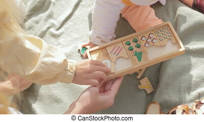 Little children collect wooden toy with numbers