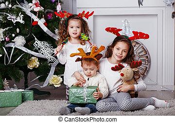 Little children in reindeer antlers