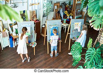 Little Children Painting in Art Studio
