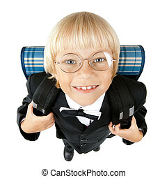 little children schoolboy stare on camera through glasses and smile, on white background, isolated