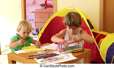 children sketching with paper