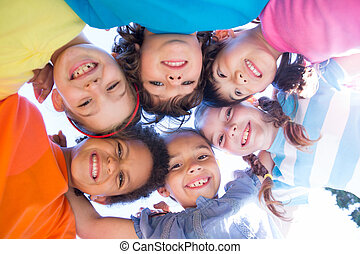 Little children smiling at camera on a sunny day