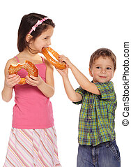 Little children with bagels, isolated on white