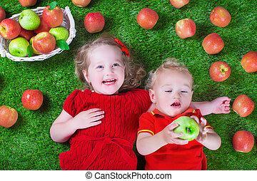 Little childrenl eating apples - Child eating apple. Little...