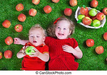 Little childrenl eating apples - Child eating apple. Little...