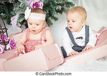 Little christmas boy and girl