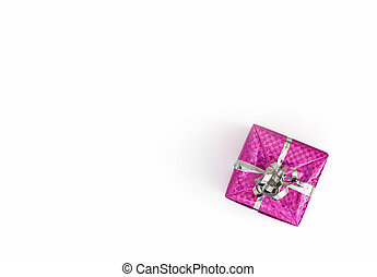 Little christmas gift with ribbon wrapped in a colorful paper