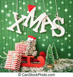Little christmas presents and XMAS in wooden letters