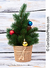 Little Christmas tree with baubles.
