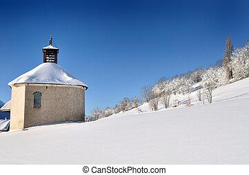 little church in snowy mountain