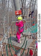 Little climber - MAGURA, ROMANIA - APRIL 05: Little girl ...