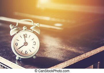 little clock on table , vintage