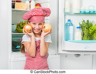 little cook holding onions