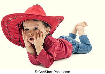 Little cowgirl in a red hat posing on a white background