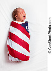 Little crying baby infant wrapped in USA flag