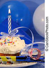 Little cupcake with blue candle - Festive decorations for...