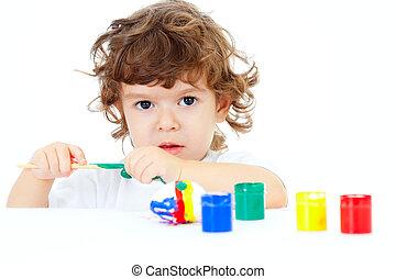 Little curly child painting egg studio shot