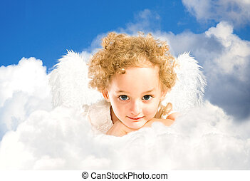 little curly girl with fairy wings lies on a cloud