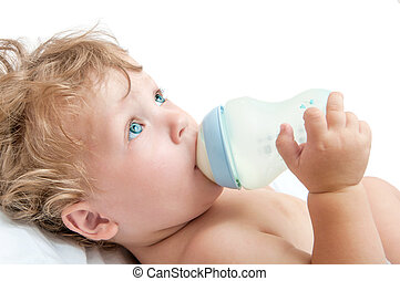 little curly-headed baby sucks a bottle of milk