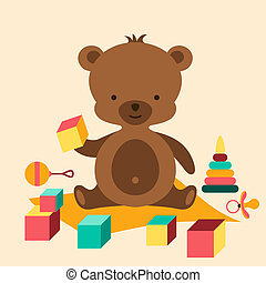 Little cute baby bear playing with toys.