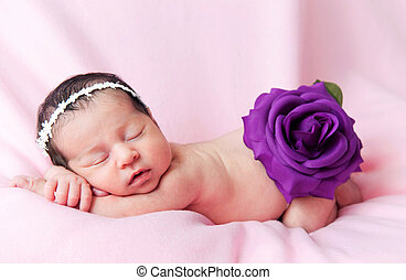 Little cute baby girl on a pink background