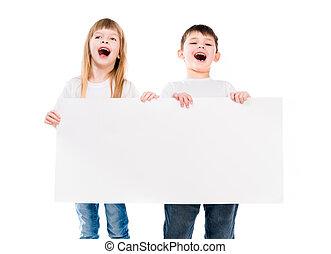 little cute boy and girl holding an empty paper sheet