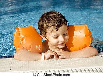 little cute boy in swimming pool