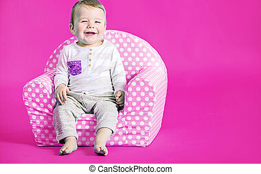 Little cute boy in the pink room