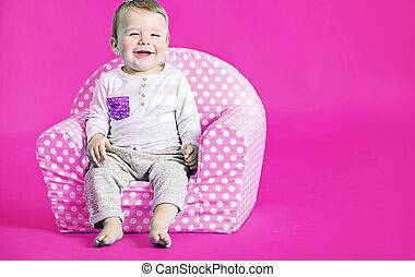 Little cute boy in the pink room