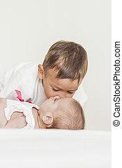 Little Cute Boy Kisses His Lovely Newborn Sister
