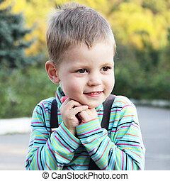 Little Cute Boy Outdoors Portrait