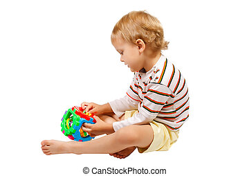 Little cute boy playing with colorful toy