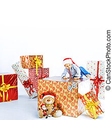 Little cute boy sitting on the gift