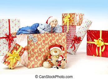 Little cute boy with plenty of gifts